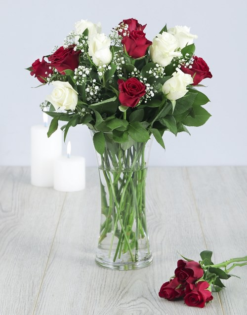 red-and-white-roses-in-a-glass-vase-v18
